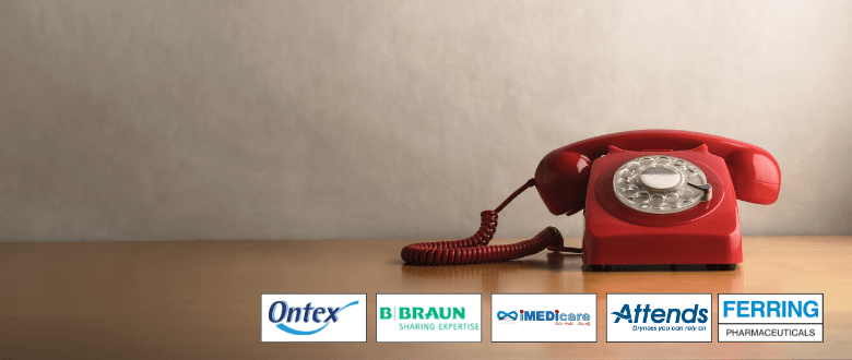 red retro telephone with company supporter logos underneath