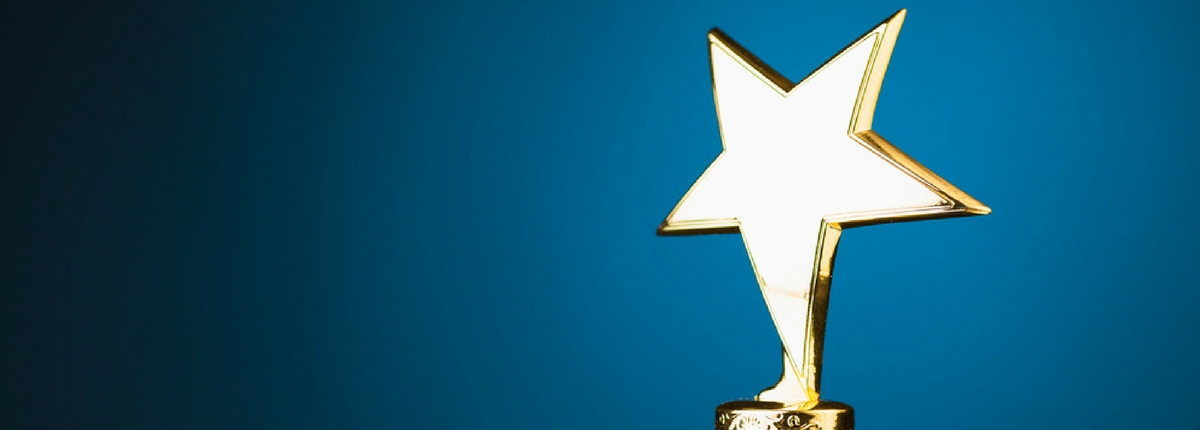 golden star trophy award with blue background