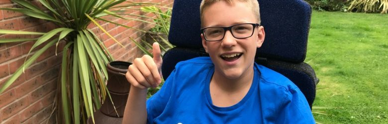 ben sat in his garden with his thumb up