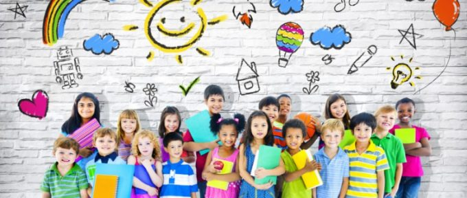 group of children smiling wearing colourful clothes