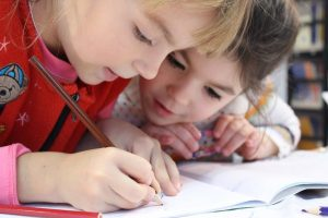 close up of children learning in the classroom