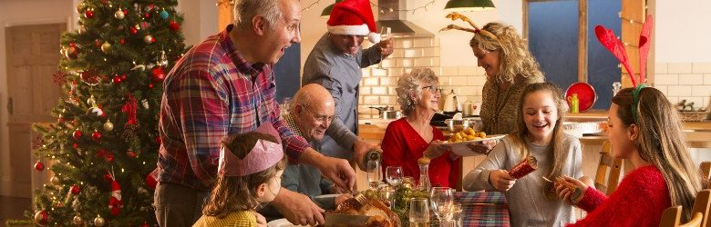 family helping to serve Christmas dinner at the table