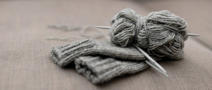 grey knitted gloves and wool material