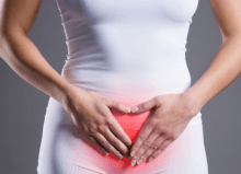 Ulcerative Interstitial Cystitis header with lady holding her stomach