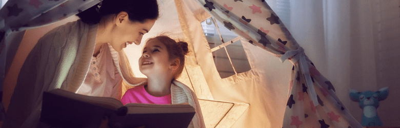 mum reading book to daughter for national read a book day