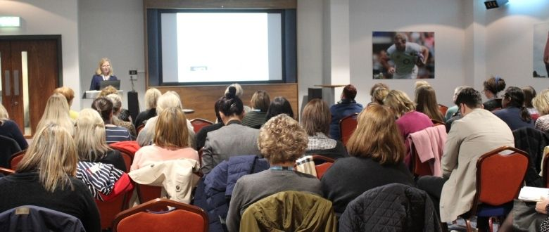 people seated for seminar at continence symposium in 2020