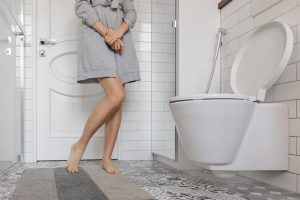 incontinent woman holding her bladder