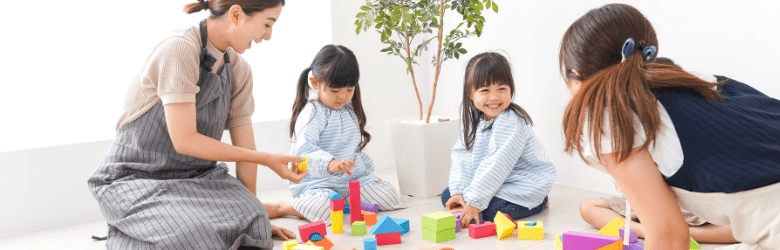 Children receiving an assessment or playing with adults